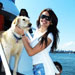 Girl with dog on board the private yacht Miss Toronto