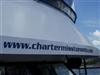 Sloping side of charter yacht Miss Toronto